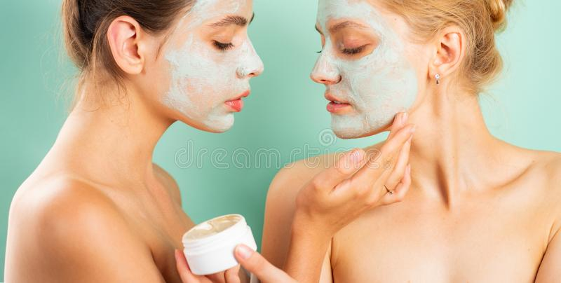 Applying clay mask. Spa and wellness. Girls friends sisters making clay facial mask. Anti age care. Stay beautiful. Skin royalty free stock photos