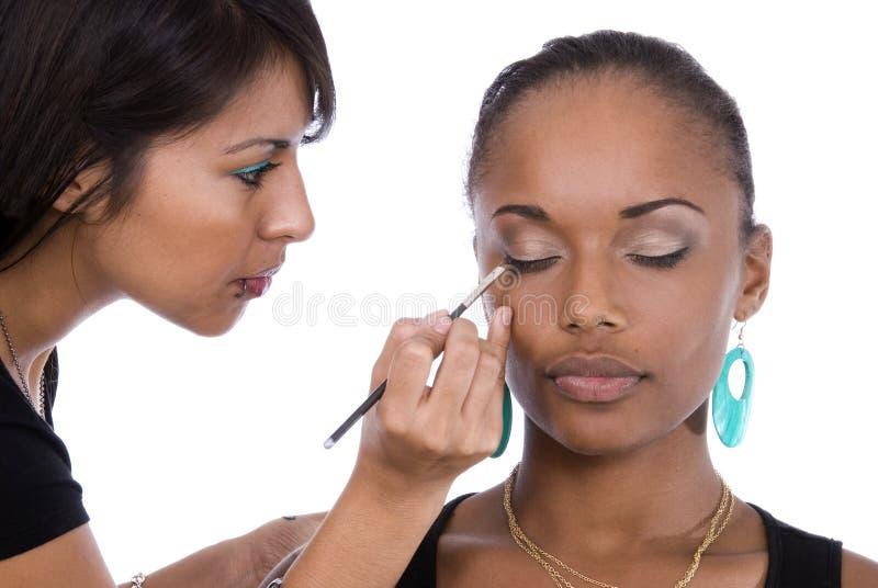 Applying eye-liner stock photo