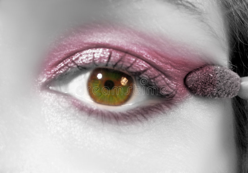Applying eyeshadow. Colorful eye and shadow on black and white concept stock image