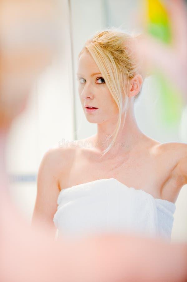 Applying Hairspray stock photos