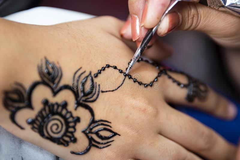Applying henna tattoo royalty free stock images