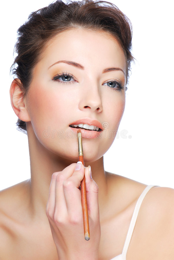 Free Applying Lipstick Using Lip Concealer Brush Stock Photo - 7341430