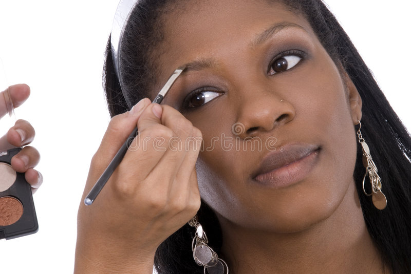 Applying make-up. stock images