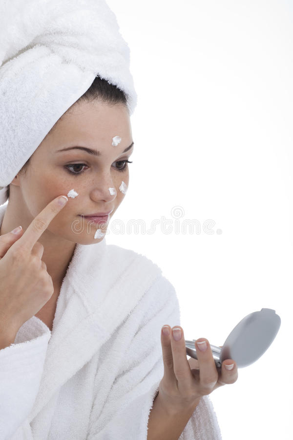 Applying Moisturizer royalty free stock photos