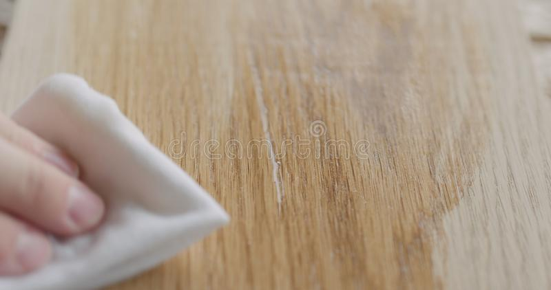 Applying oil finish to oak surface with cloth. Wide photo stock photography