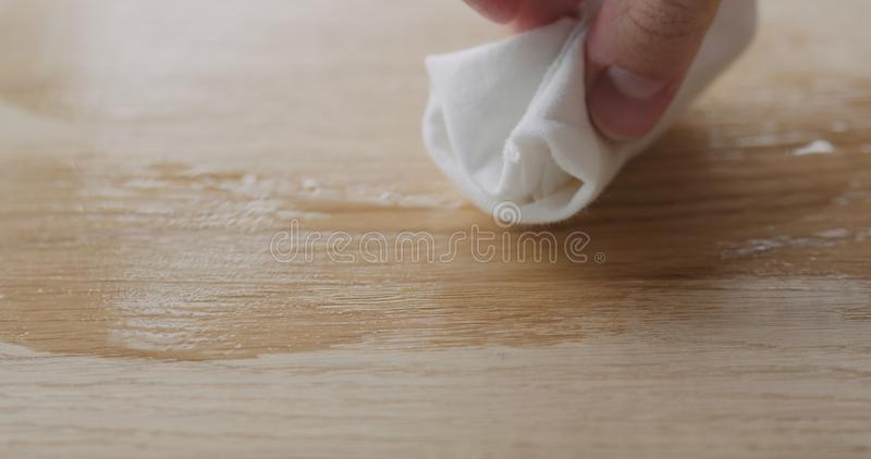 Applying oil finish to oak surface with cloth. Wide photo royalty free stock photos