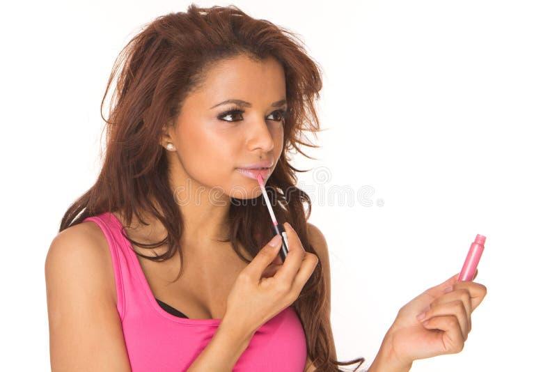 Applying pink lipgloss royalty free stock photos
