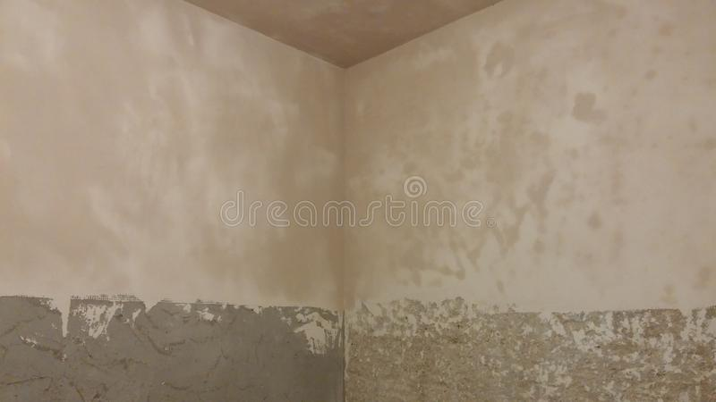 Applying plaster on the walls - corner royalty free stock images