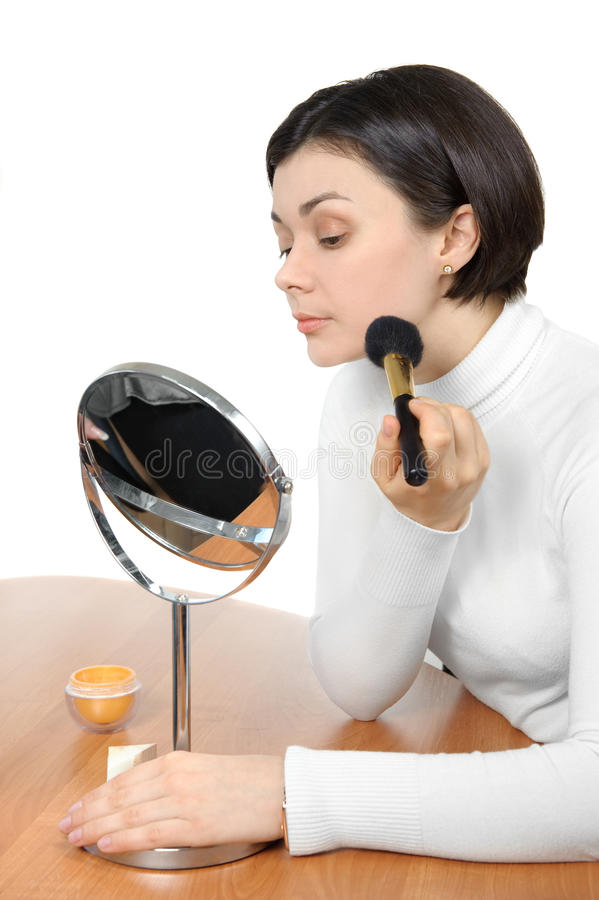 Applying powder using soft brush royalty free stock images