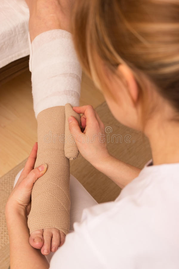 Applying a pressure bandage stock photo