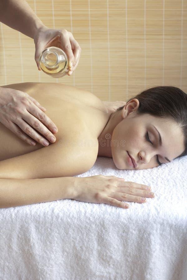 Appoggi il massaggio con olio immagini stock libere da diritti