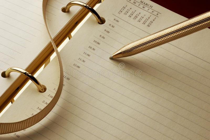 Appointment calendar and pen royalty free stock photo