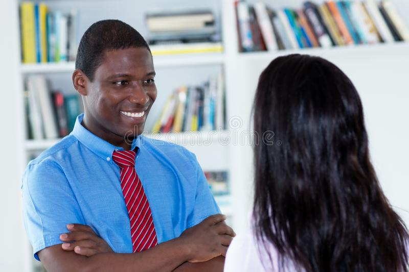 Appraisal interview of african american businessman and secretary royalty free stock images