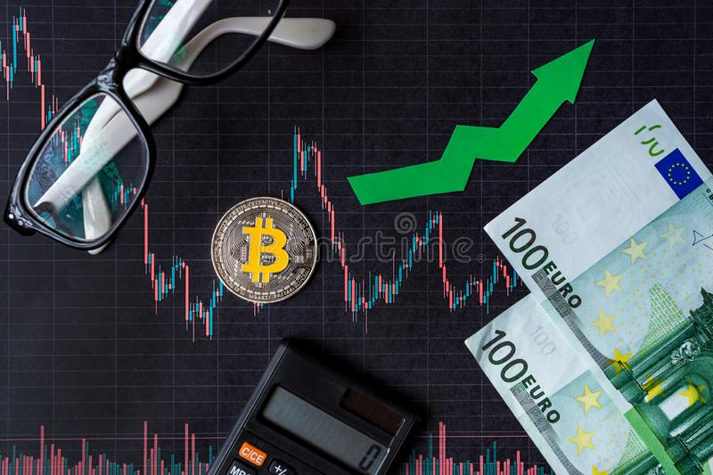 Appreciation of virtual money bitcoin. Green arrow and silver Bitcoin on paper forex chart index rating go up exchange market stock photography