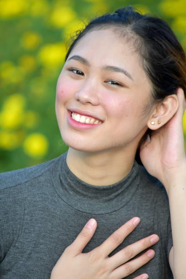 Appreciative Adult Female. A pretty asian adult female stock image