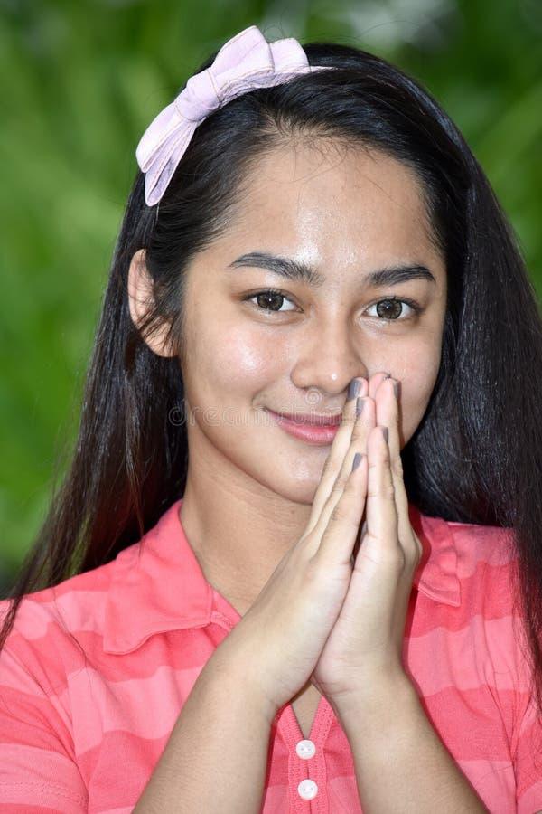 Appreciative Beautiful Person. A young pretty asian teenage girl royalty free stock photo