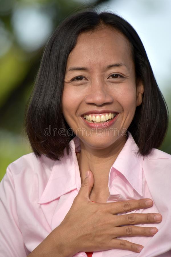 Appreciative Diverse Adult Female. An attractive and asian person royalty free stock images
