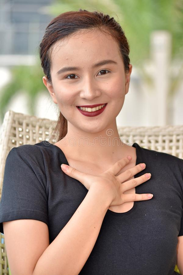An Appreciative Diverse Female. An attractive and asian person royalty free stock photo