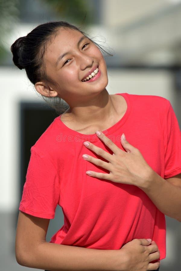 Appreciative Female Juvenile. A young pretty asian teenage girl stock photos