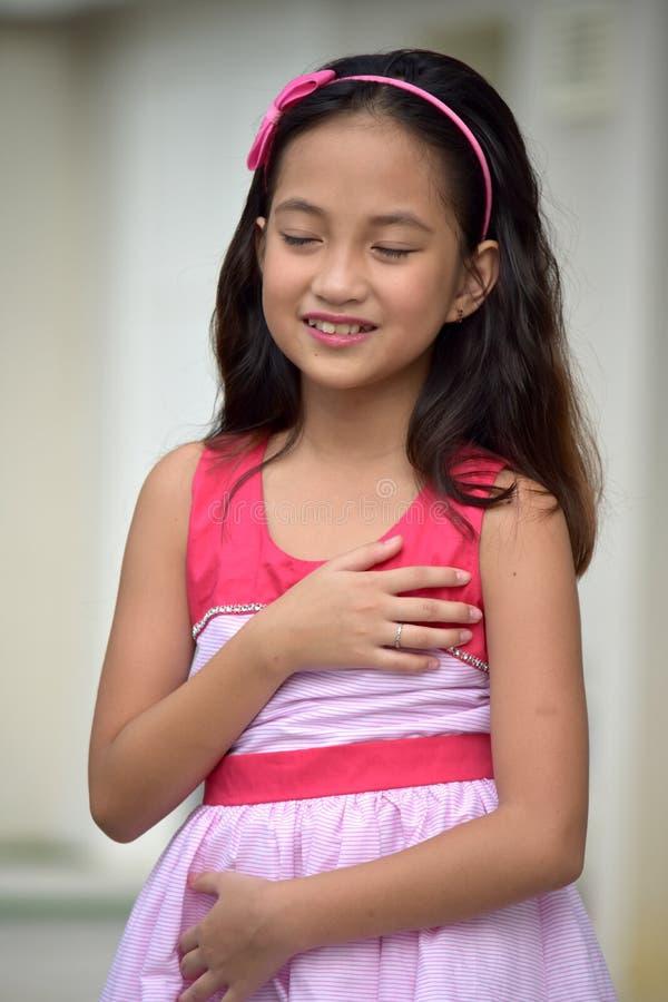 Appreciative Female Juvenile. An attractive young asian person stock image