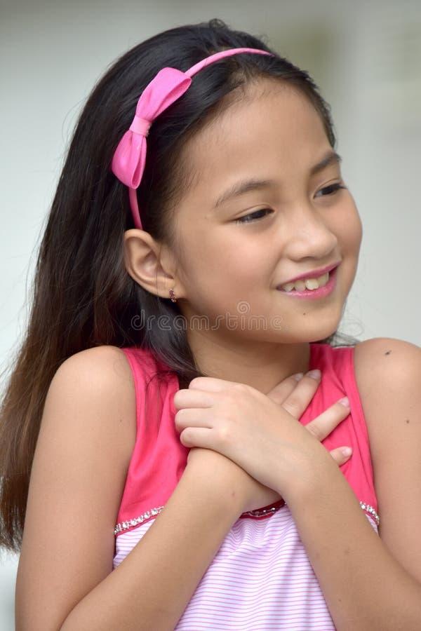 Appreciative Filipina Female. A pretty young asian female stock images
