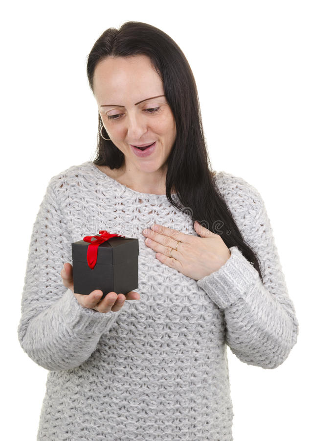 Appreciative of gift. Appreciative woman after receiving gift royalty free stock photos
