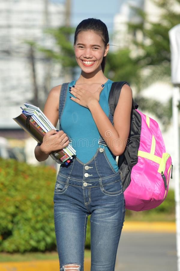 Appreciative Girl Student With Books. An attractive and asian person stock photography