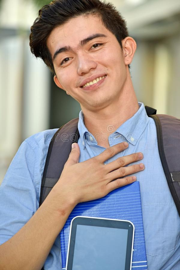 An Appreciative Male Student. An attractive and asian person stock images
