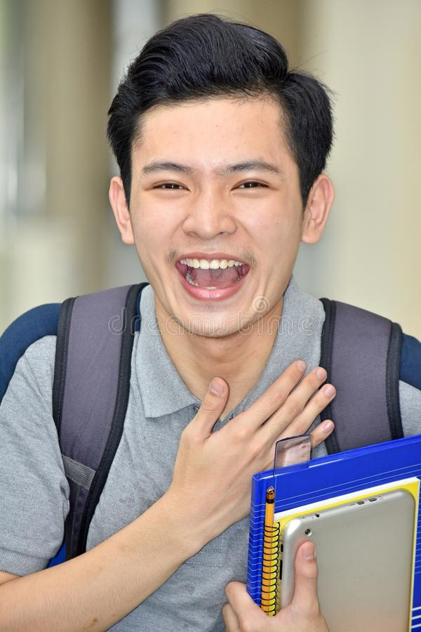 Appreciative Minority Person With Notebooks. An attractive and asian person stock photo