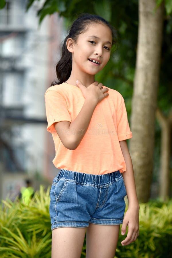 Appreciative Pretty Minority Person. An attractive and asian person royalty free stock photo