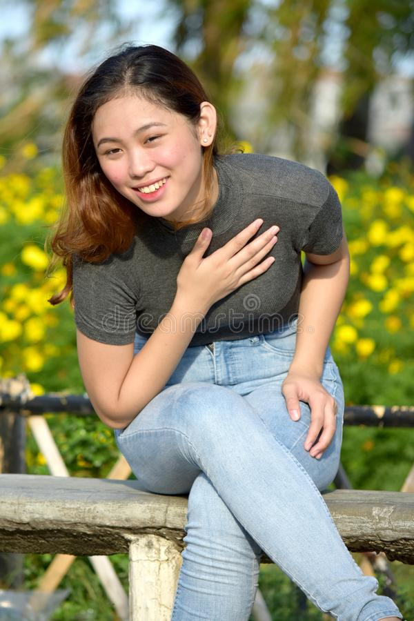 Appreciative Young Adult Female. A pretty young asian female royalty free stock image