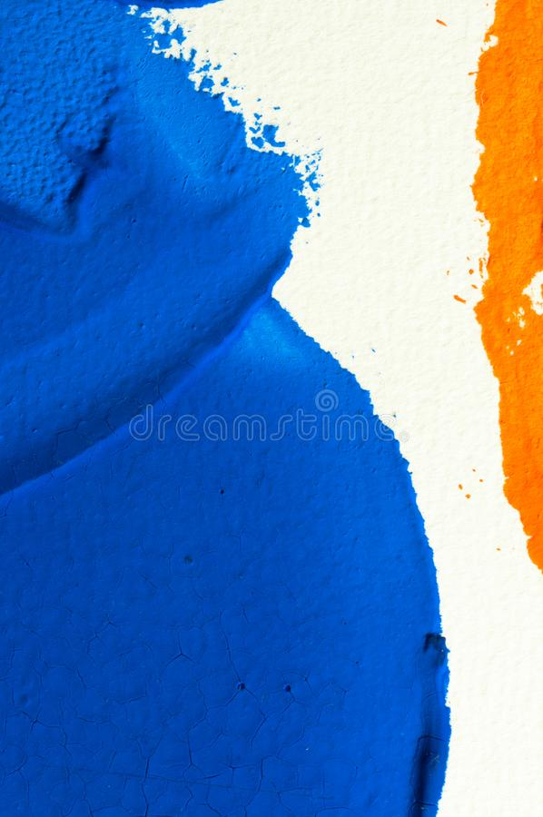 Blue and orange gouache color, image detail. Apprehend abstract painting, printmaking, brilliant blue and orange gouache watercolor on white, image detail royalty free stock images
