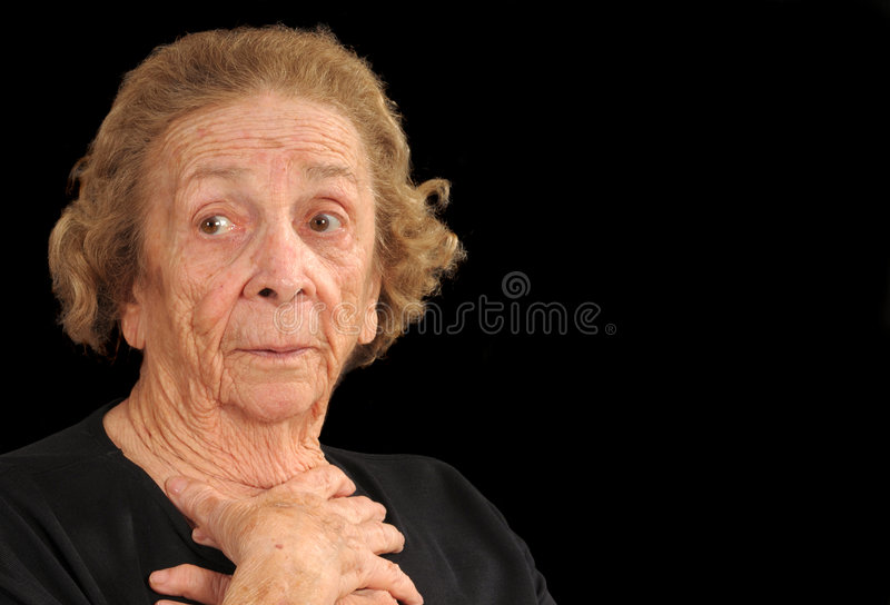 Apprehensive. Elderly woman holding hands in a gesture of apprehension stock photos