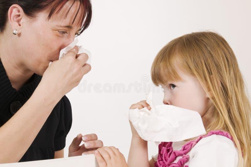 Apprenez à souffler à un nez photo libre de droits