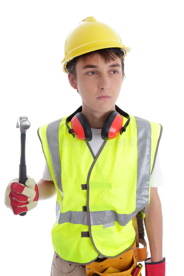 Apprentice builder construction worker. Apprentice builder holding a hammer. White background royalty free stock photography