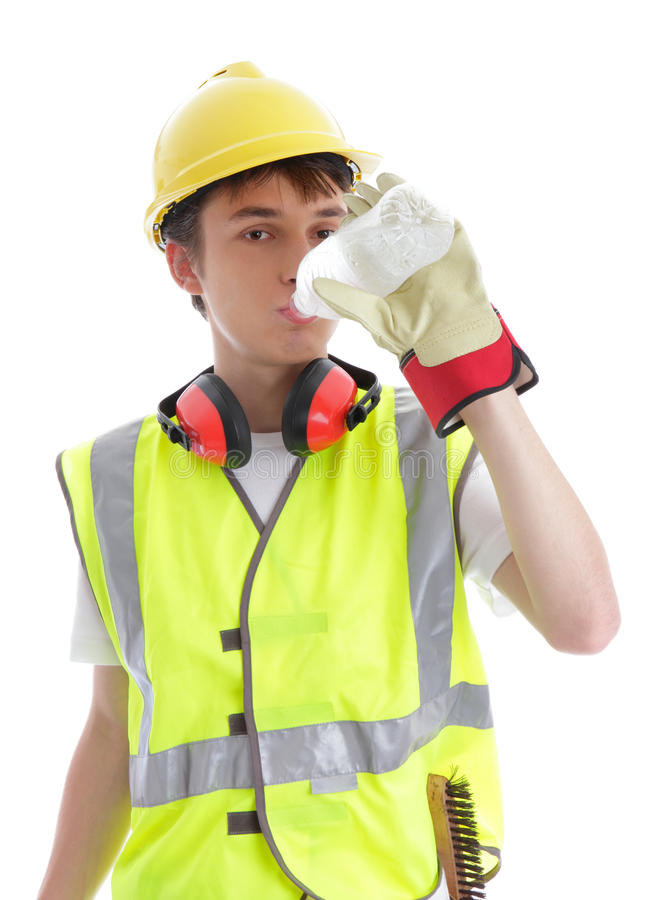 Apprentice builder drinking ice cold water royalty free stock photo