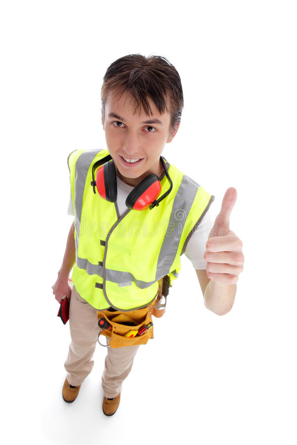 Apprentice builder thumbs up. Smiling apprentice builder thumbs up. White background royalty free stock photography
