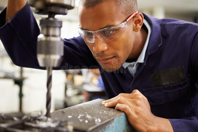 Apprentice Engineer Using Milling Machine. Close Up Image Of An Apprentice Engineer Using Milling Machine royalty free stock image