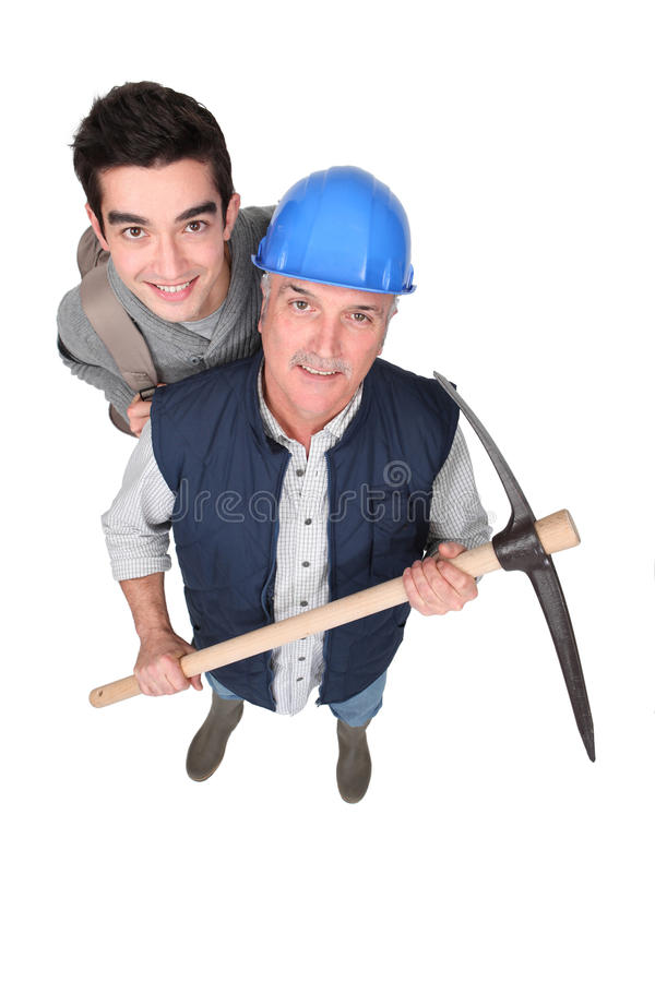 Apprentice and senior mentor royalty free stock photo
