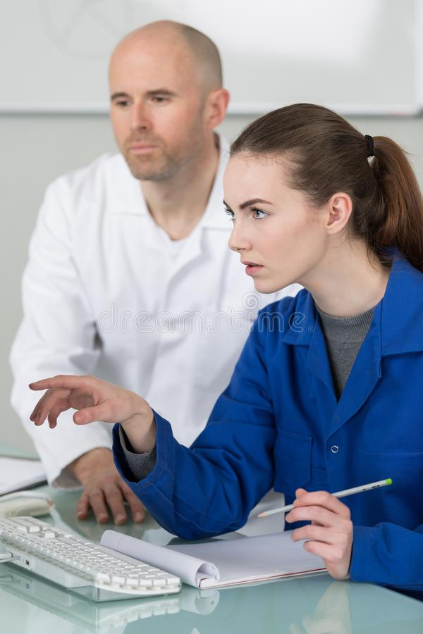 Apprentice taking some notes. Work stock photography