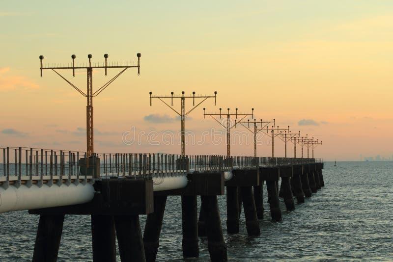 Sea, pier, sky, horizon, calm, fixed, link, sunset, morning, sunrise, ocean, water, dusk, dawn, evening, energy, bridge stock image