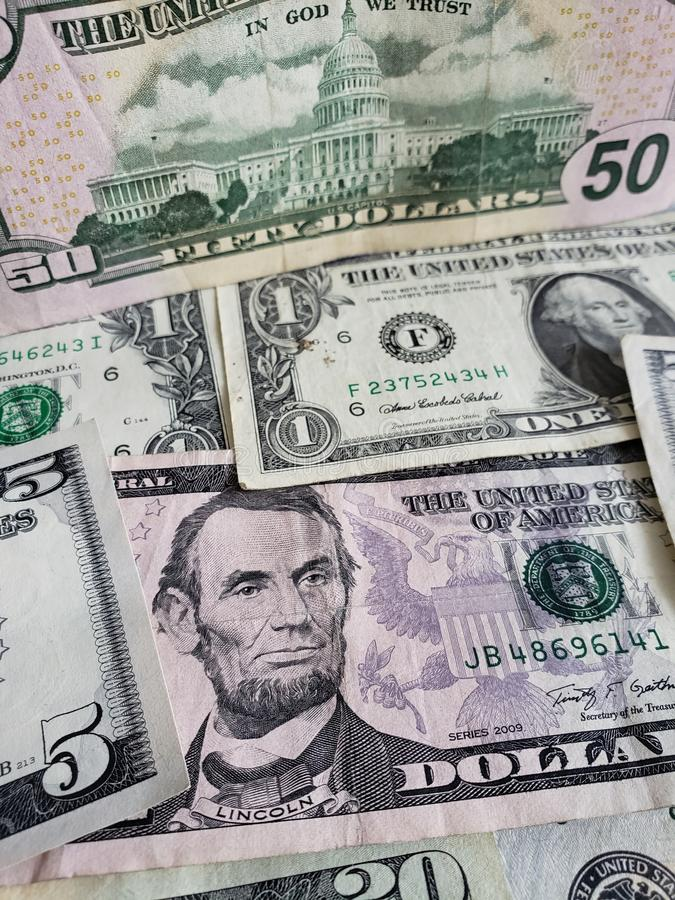 Approach to American dollars banknotes of different denominations, background and texture. American dollars banknotes of different denominations, background stock photos