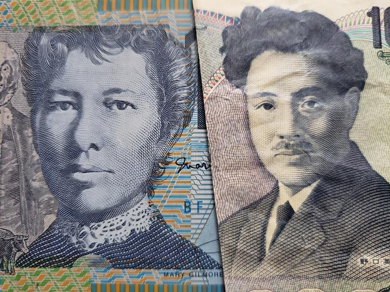 Approach to Australian banknote of ten dollars and Japanese banknote of 1000 yen. Commerce, exchange, trade, trading, value, buy, sell, profit, price, rate stock image