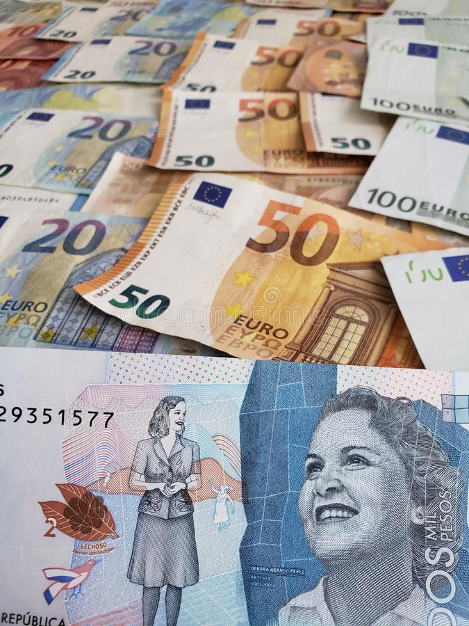 Approach to colombian banknote and euro bills. European, cop, pesos, commerce, exchange, travel, trade, trading, value, buy, sell, profit, price, rate, cash royalty free stock image