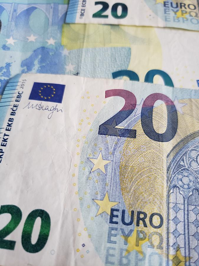 approach to european banknotes of twenty euro, background and texture stock photos