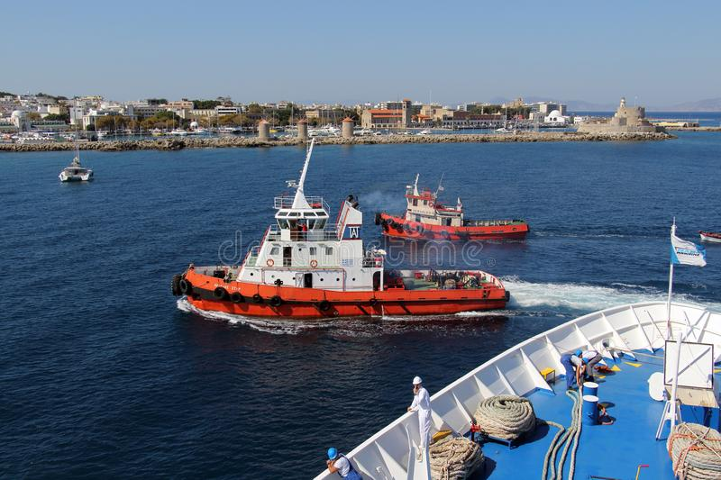 On the approach to the island of Rhodes, towboats and upper desk. Of Golden Iris. OCT-13-2017 stock photos