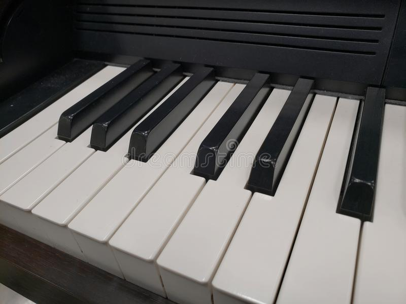 Approach to a musical keyboard, background and texture. Music and sound, melody and harmony, used in different styles and musical genres, composition and royalty free stock image