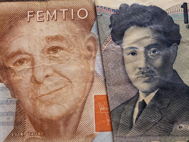 Approach to swedish banknote of fifty kronor and Japanese banknote of 1000 yen. Commerce, exchange, trade, trading, value, buy, sell, profit, price, rate, cash stock photos