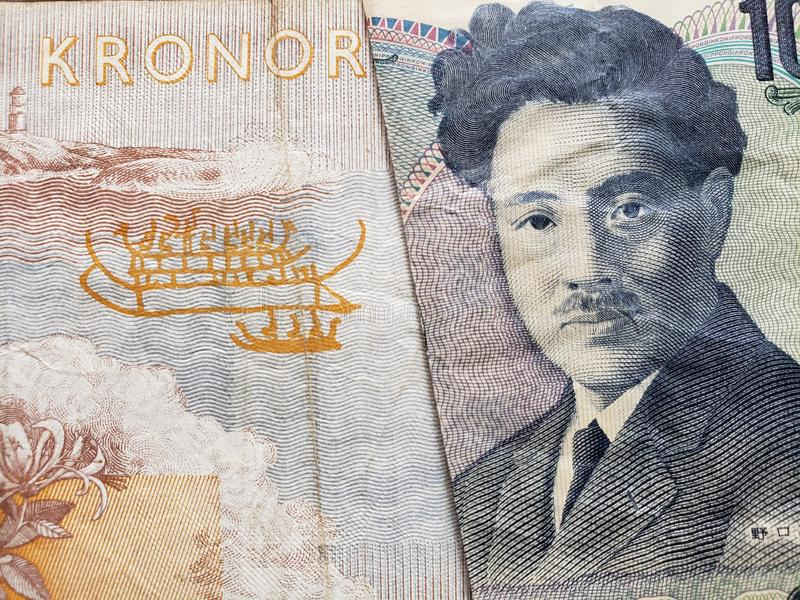 Approach to swedish banknote of fifty kronor and Japanese banknote of 1000 yen. Commerce, exchange, trade, trading, value, buy, sell, profit, price, rate stock photo