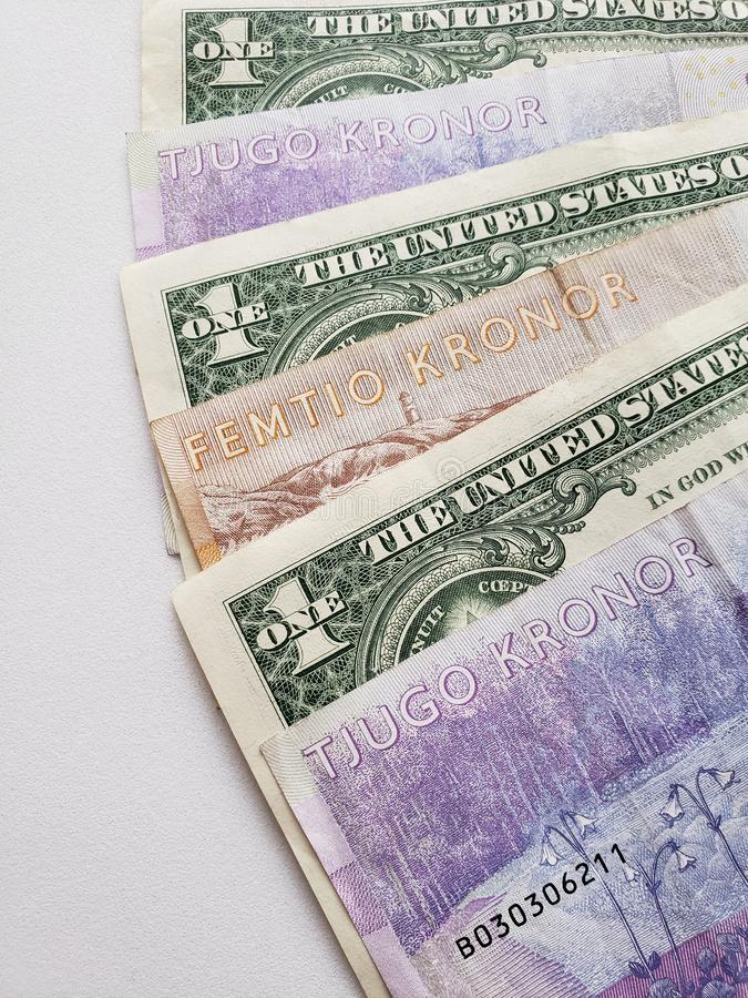 Approach to swedish banknotes and American one dollar bills. Commerce, exchange, travel, trade, trading, value, buy, sell, profit, price, rate, cash, currency stock photos